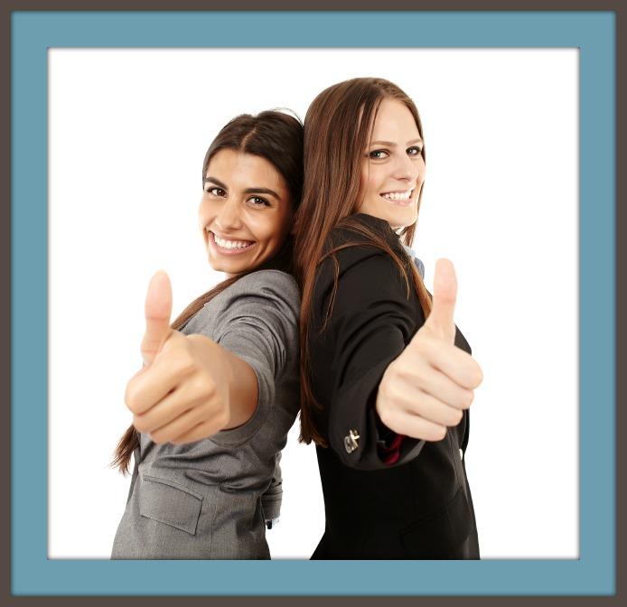 women thumbs up framed