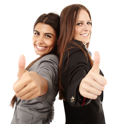 Businesswomen making thumbs up sign